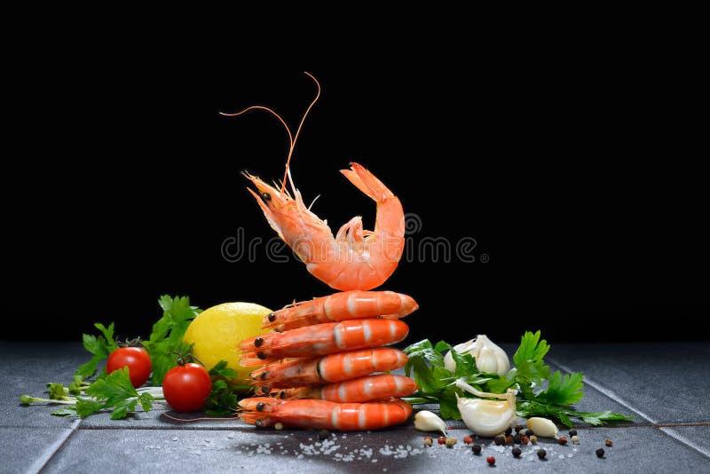 Cooked shrimps,prawns. With seasonings on stone background royalty free stock photo