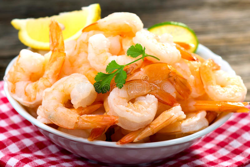 Cooked shrimps. On wooden background royalty free stock photos
