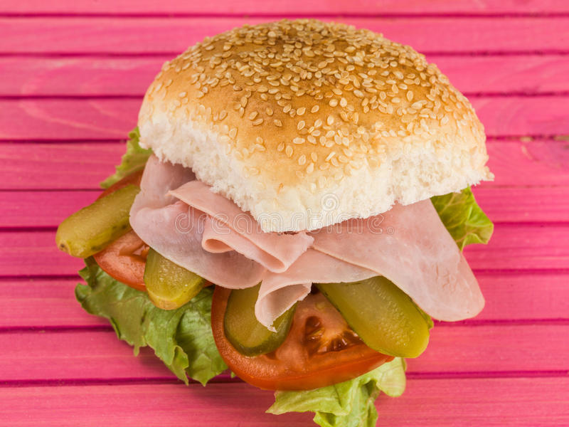 Cooked Smoked Ham With Gherkins Salad Sesame Seed Bread Roll or Bun Sandwich royalty free stock photography