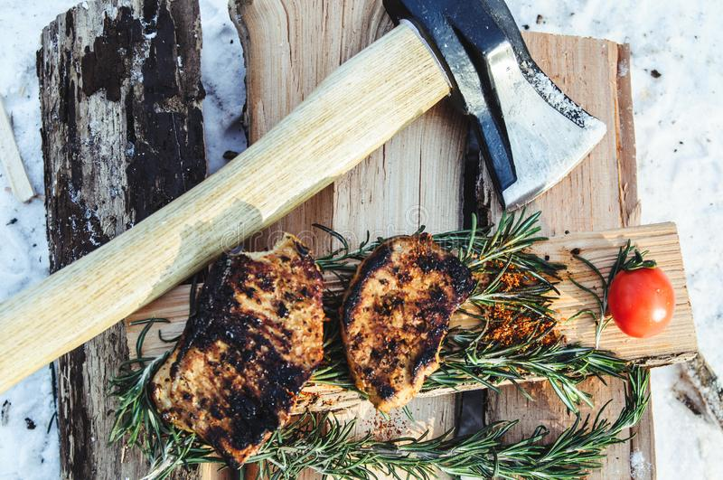 Cooked steaks from meat. On a fire on a journey stock photos
