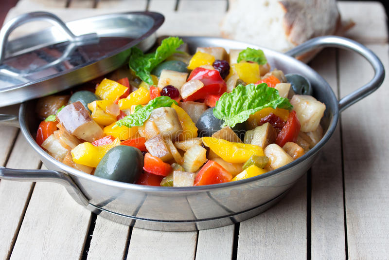 Cooked vegetable salad made from chopped fried eggplant. Traditional sicilian dish. stock photography