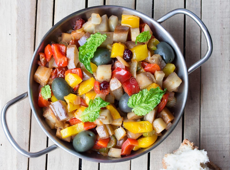Cooked vegetable salad made from chopped fried eggplant. Traditional sicilian dish. royalty free stock image