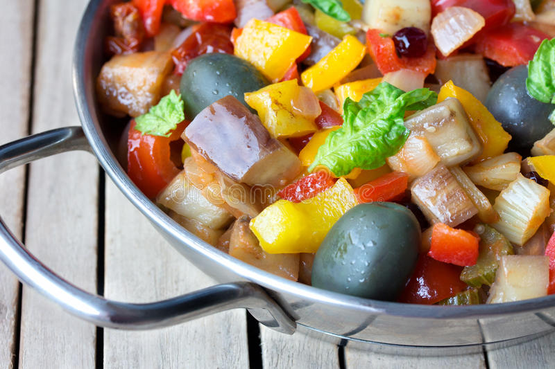 Cooked vegetable salad made from chopped fried eggplant. Traditional sicilian dish. royalty free stock photos