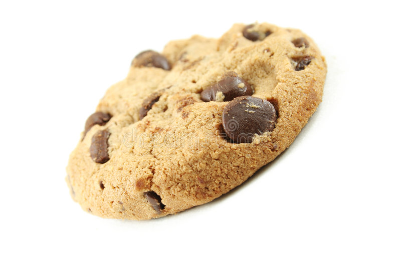 Cookie. Close up of delicious chocolate chip cookie isolated on white - narrow focus royalty free stock images