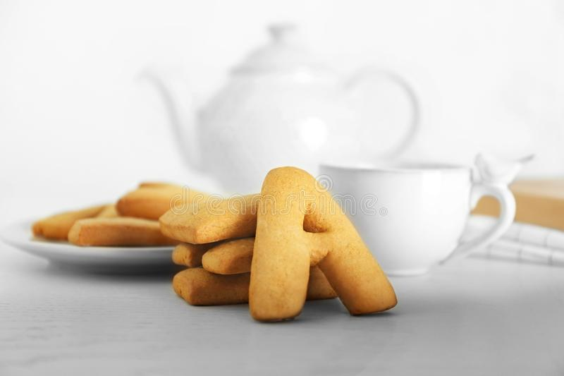 Cookie alphabet and tea royalty free stock photos