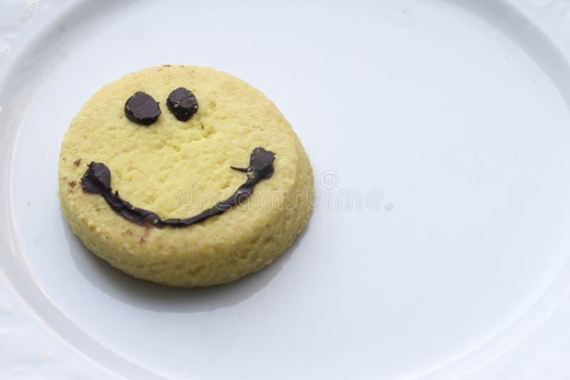 Cookie da cara do smiley imagens de stock royalty free