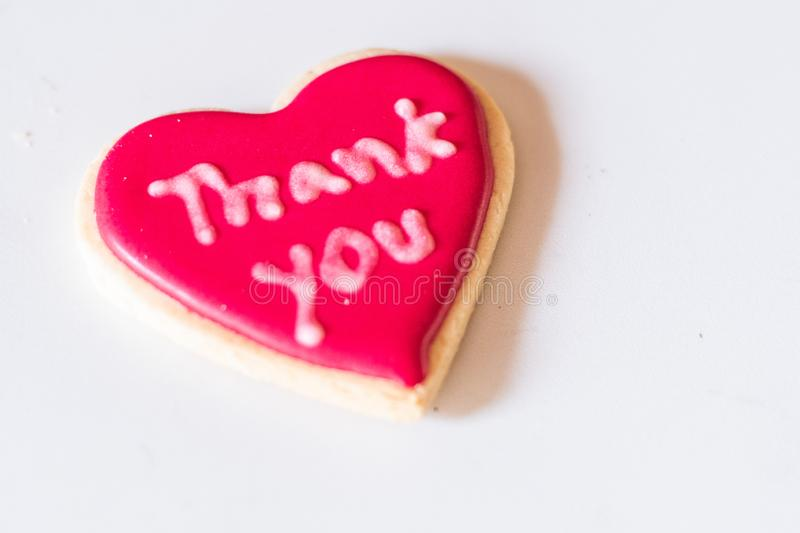 Cookie dessert thank you heart red shape stock image