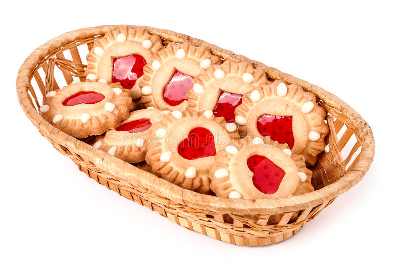 Cookie with heart in wicker basket isolated on white background royalty free stock photos