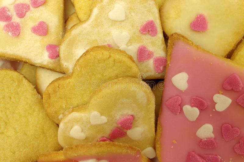 Cookie hearts. Handmade cookie hearts with hundreds and thousands stock image