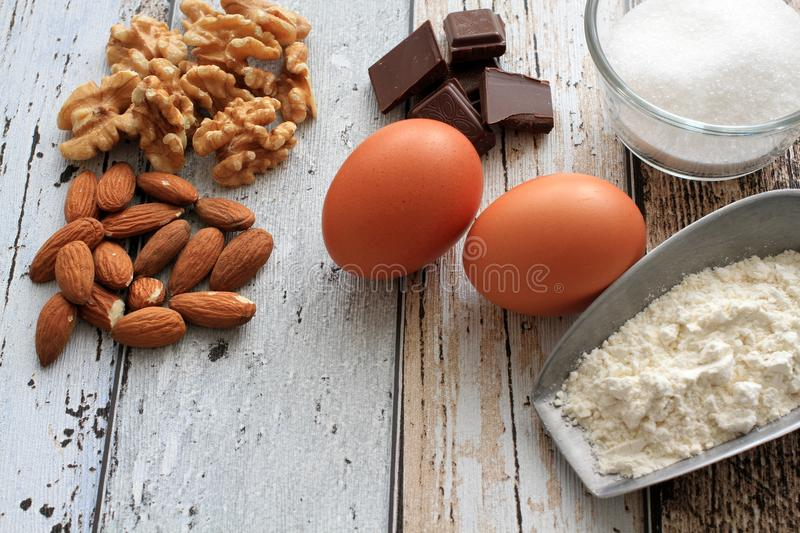 Cookie ingredients almonds, walnuts, chocolate, sugar, flour and eggs royalty free stock image
