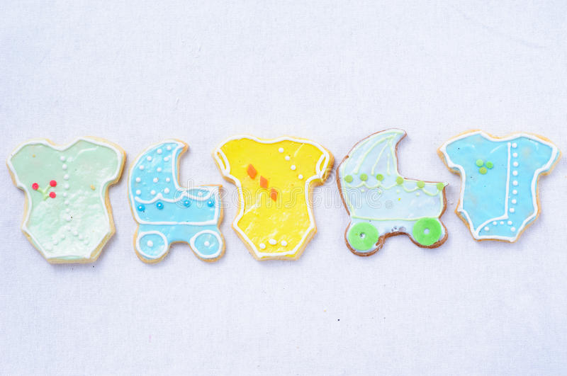 Cookies. In the shape of the pram and clothes royalty free stock photo