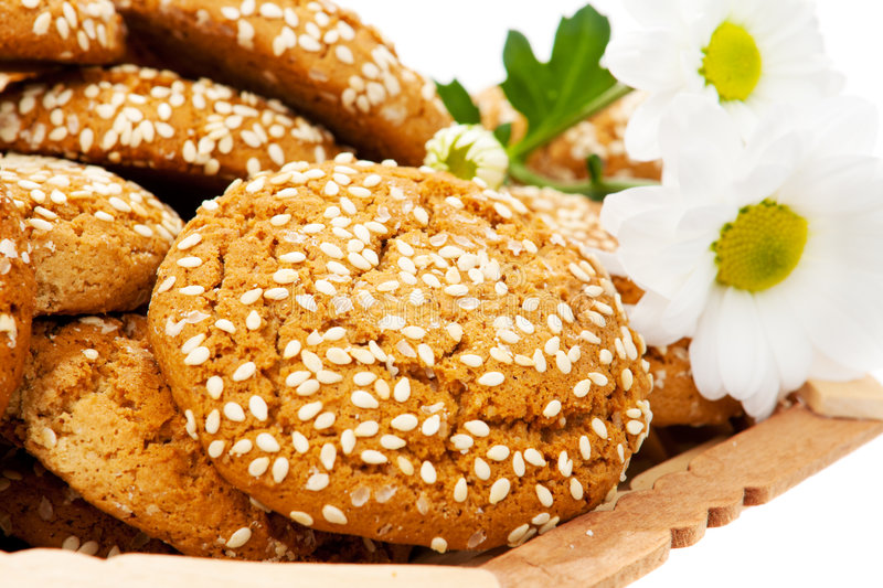 Cookies. Covered with sesame and daisies royalty free stock photography