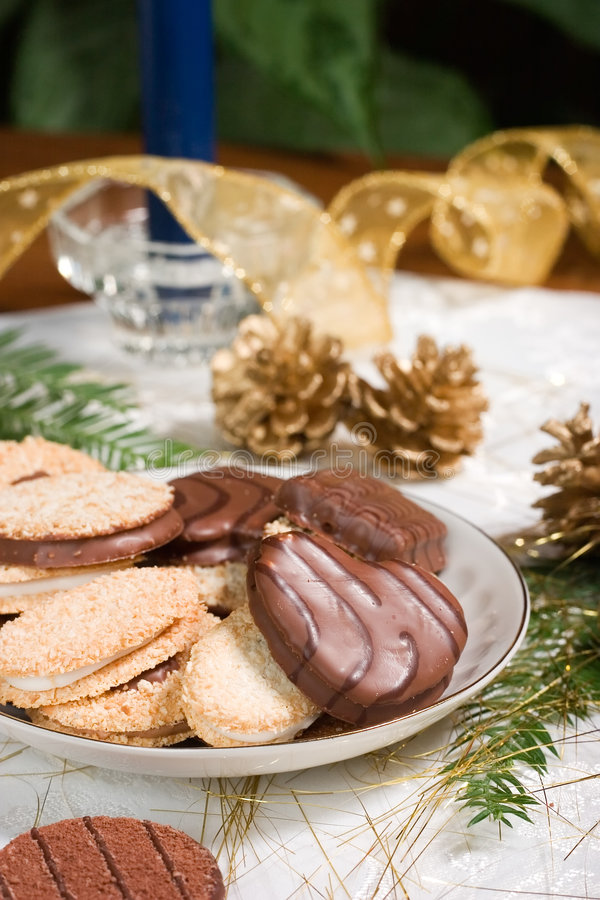 Download Cookies, Blue Candle, Fir Branch And Pine Cones On Holiday Napki Stock Photo - Image: 1424282