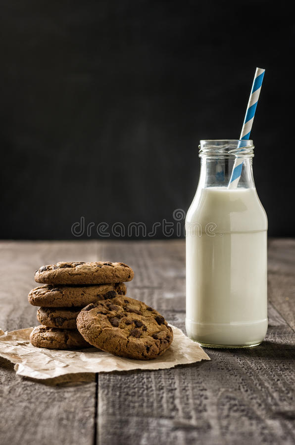 Cookies and a bottle of milk. Chocolate cookies and a bottle of milk stock photo