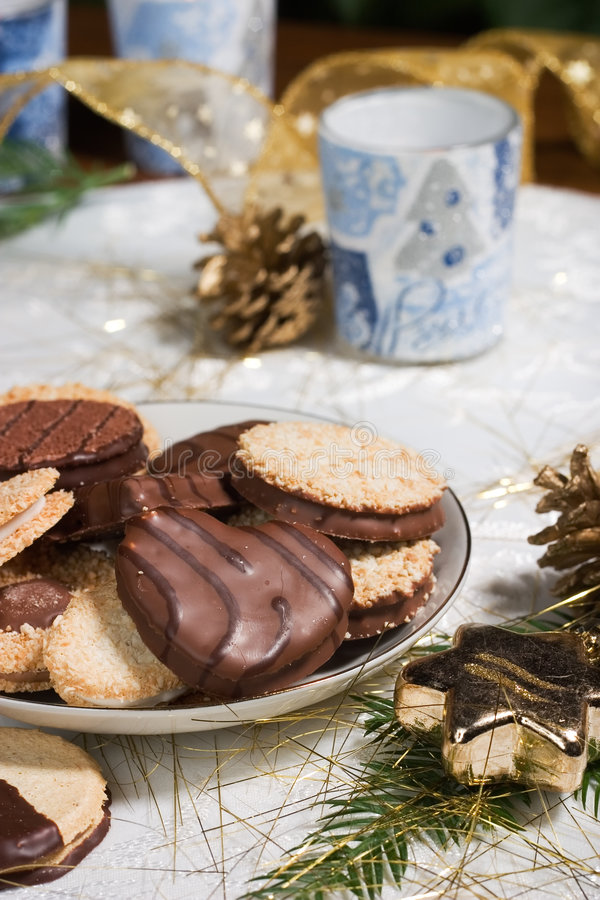 Download Cookies, Candles And Pine Cones On Holiday Napkin Stock Photo - Image: 1424270