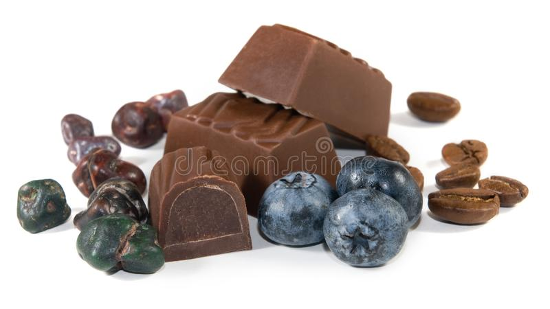 Cookies with chocolate candy and blueberries on a white background. Closeup stock images