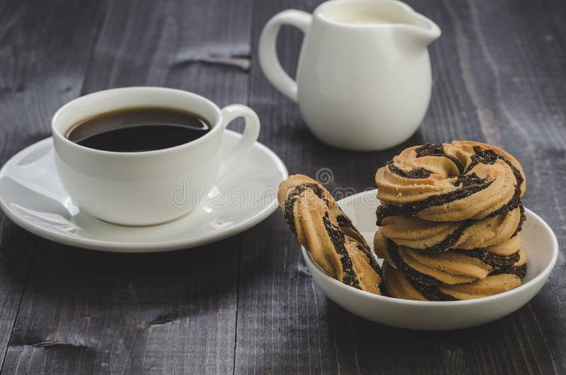 cookies, coffee and creamer     cookies, coffee and creamer on a wooden table stock images