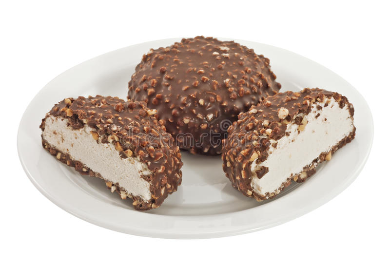 Cookies covered with chocolate on a plate isolated. Cookies covered with chocolate and nuts on a plate isolated stock images