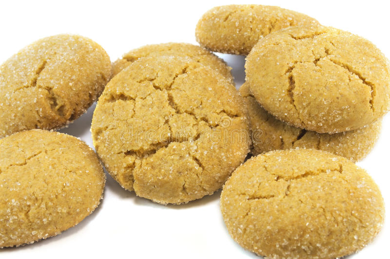 Cookies covered with sugar isolated over white. Close-up of cookies covered with sugar isolated over white stock photography