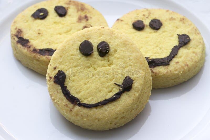 Cookies da cara do smiley imagens de stock