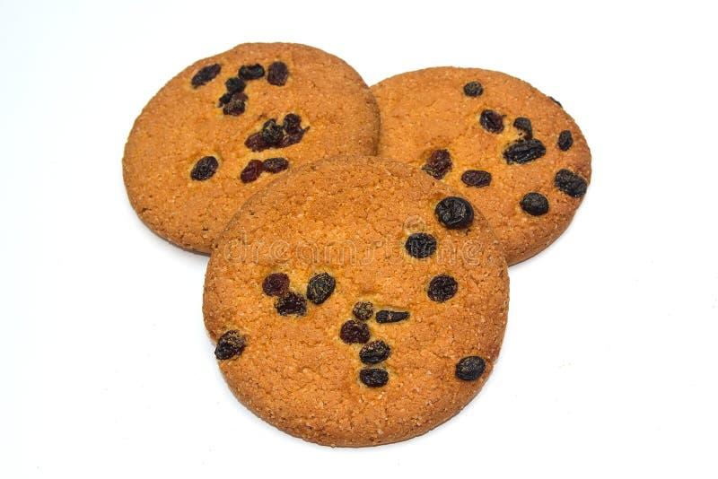Cookies de farinha de aveia com as passas isoladas no fundo branco imagem de stock royalty free