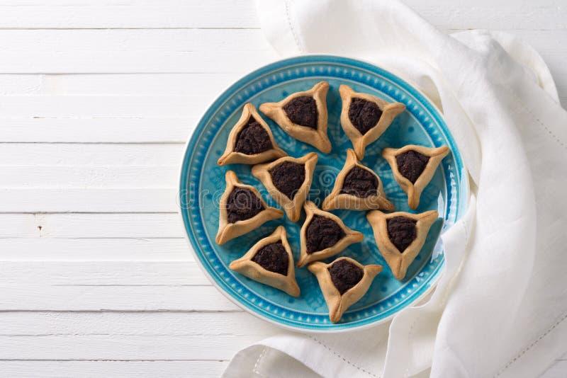 Cookies de Hamantashen ou orelhas de Haman, cookies triangulares com sementes de papoila foto de stock royalty free