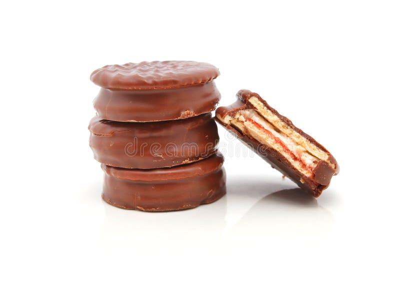 Cookies do chocolate com mordida fotos de stock royalty free