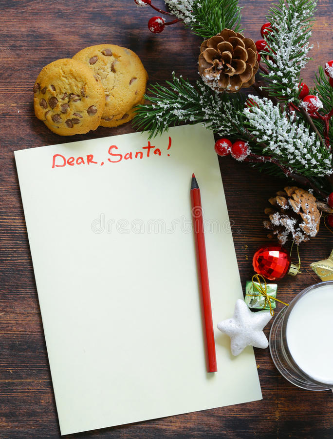 Cookies e um vidro do leite para Santa imagens de stock royalty free