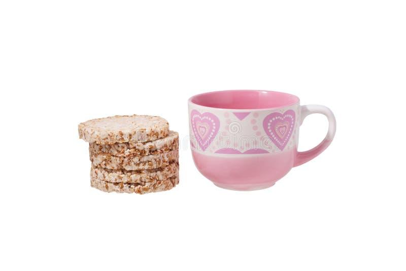 Cookies e um vidro do rosa fotografia de stock