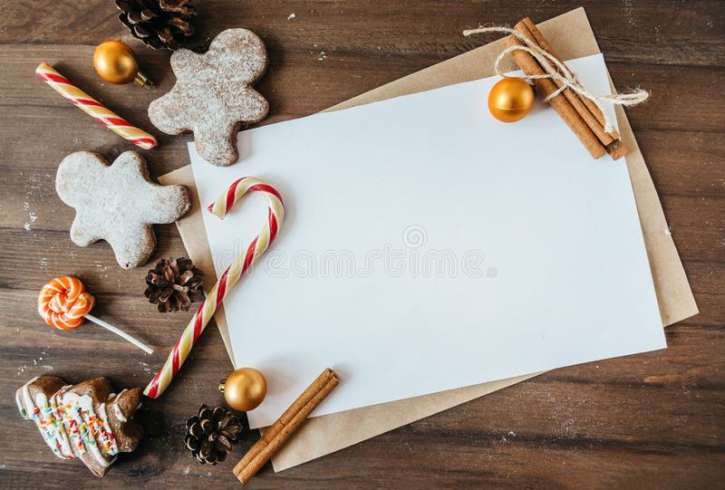 Cookies in the form of Christmas trees, gingerbread man on a brown background, a place for the inscri. Cookies in the form of Christmas trees, gingerbread man on stock images