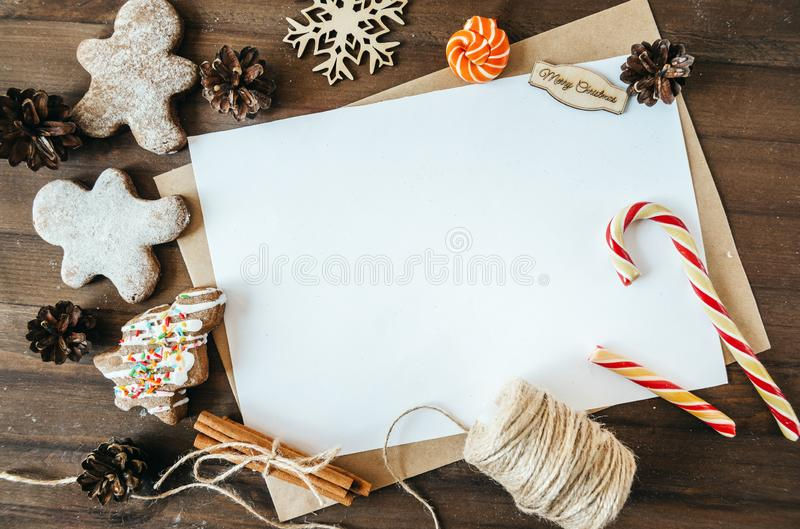 Cookies in the form of Christmas trees, gingerbread man on a brown background, white sheet in the handle,  cones. Cookies in the form of Christmas trees royalty free stock photo
