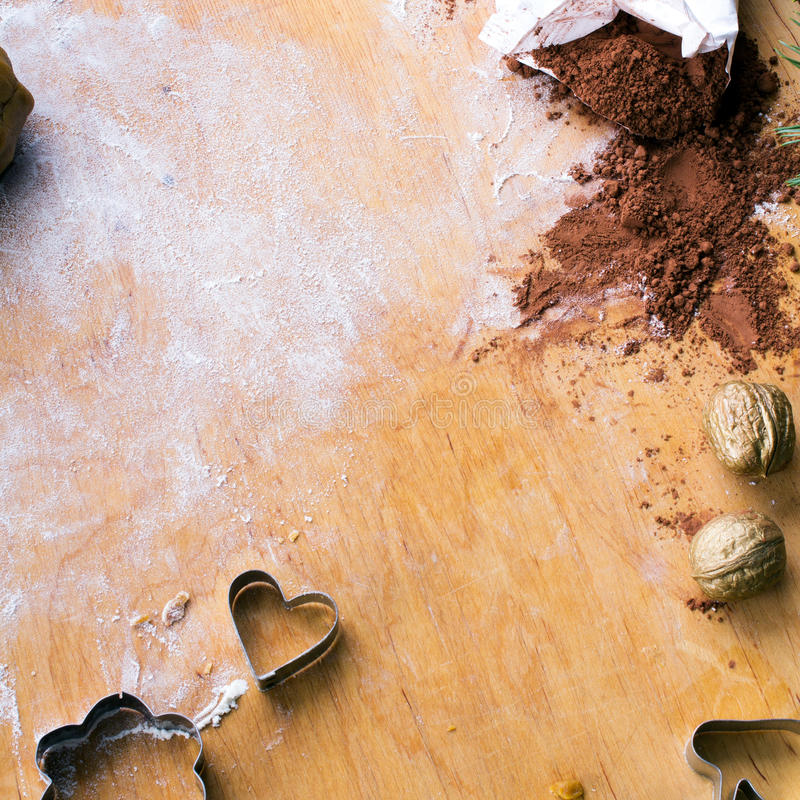 Cookies forms and gingerbread dough on wooden pastry board. Copy space royalty free stock photo