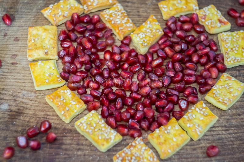Cookies with garnets on a cutboard stock photo