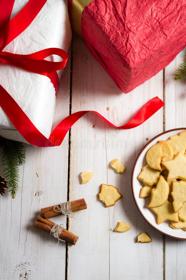 Cookies and gifts at Christmas time royalty free stock images