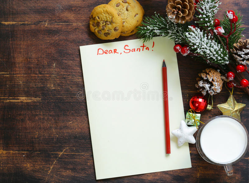Cookies and a glass of milk for Santa. Christmas royalty free stock photography