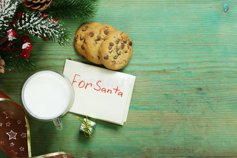 Cookies and a glass of milk for Santa. Christmas stock photo