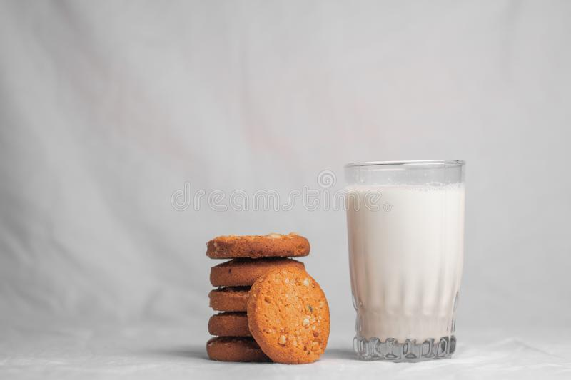 Cookies and glass of milk on white background royalty free stock images