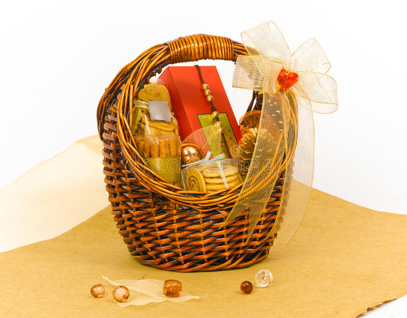 Cookies hamper basket. Hamper basket with cookies and chocolates box decorate by ribbon royalty free stock photo