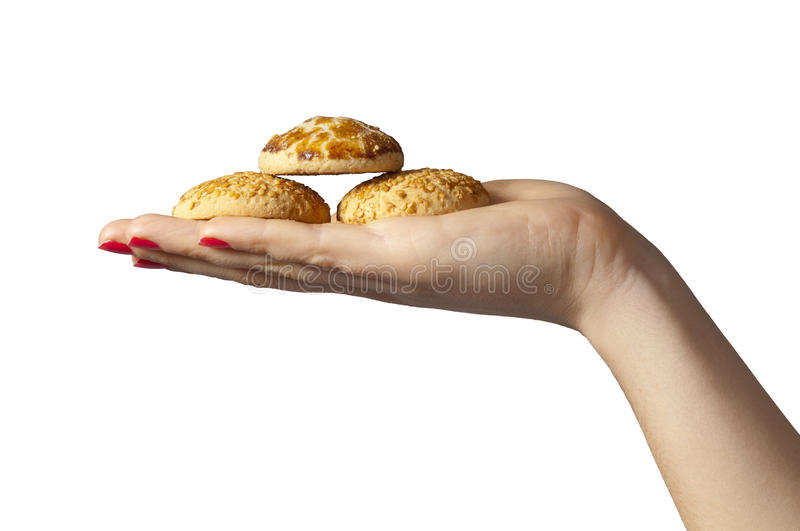 Isolated Cookies on Hand. Isolated photo of cookies, being served by a young female hand stock images