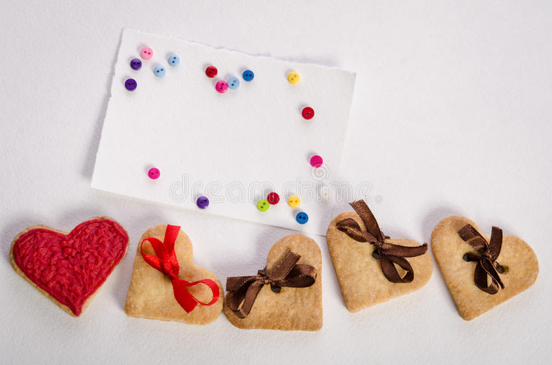 Cookies-hearts, empty card and colorfull buttons royalty free stock image