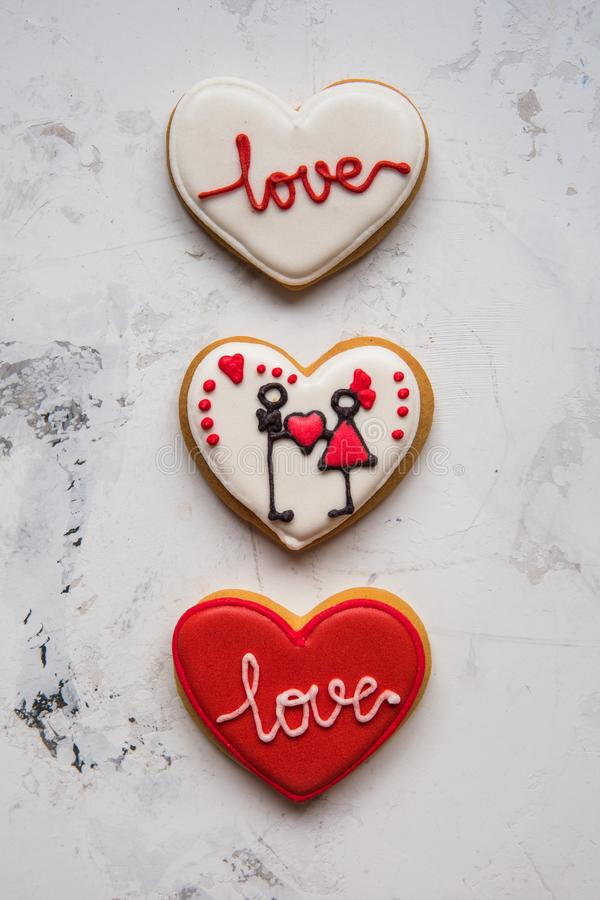 Cookies hearts with white and red icing Love for Valentine`s Day royalty free stock photos