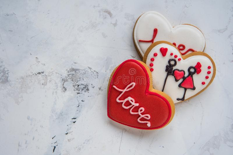 Cookies hearts with white and red icing Love for Valentine`s Day stock photos