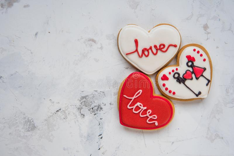 Cookies hearts with white and red icing Love for Valentine`s Day royalty free stock photo