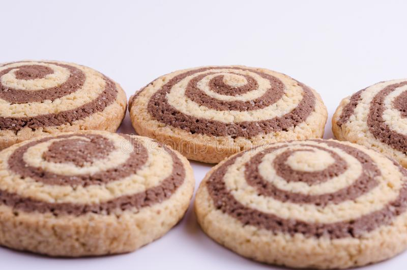 Cookies with the image of a spiral on a light background stock photography