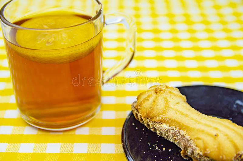 Cookies with lemon tea on the table royalty free stock photography