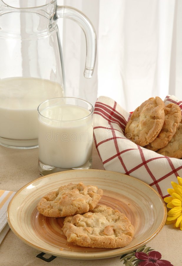 Cookies and Milk. A baskets of cookies and a pitcher of milk stock photo