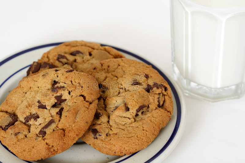 Cookies and milk. Three cookies and a glass of milk royalty free stock photography