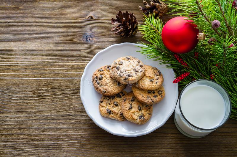 Cookies and milk for Santa Clause on wood background. Copy space stock photo