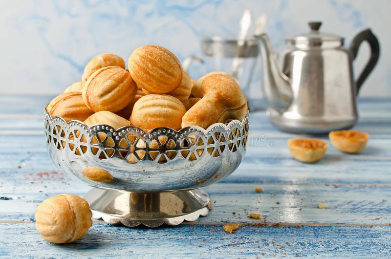 Cookies `Nuts` with condensed milk and nuts. Homemade cookies royalty free stock images