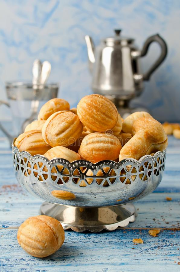 Cookies `Nuts` with condensed milk and nuts stock photography